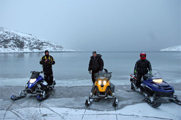 Snowmobile expeditions to Barents Sea on Kola Peninsula. Northwest Russia