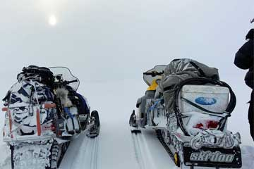 Snowmobile safaris to Barents Sea on Kola Peninsula. Northwest Russia